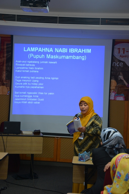 Picture 3. Ms. Siti Solihah, a training participant, participates during the session of Competency in Written Language (Reading and Writing) and practices the correct way of reading the Sundanese poem with its particular intonation.