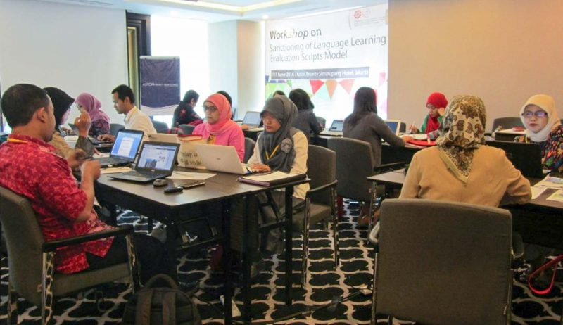 The participants work in language group to revise language evaluation model scripts.